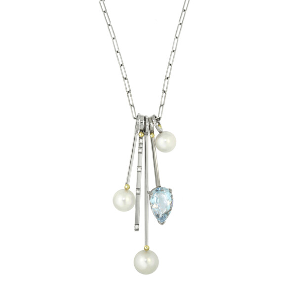 Closeup photo of Blue Topaz, Pearl & Diamond Stack Charm Necklace- 5 stack