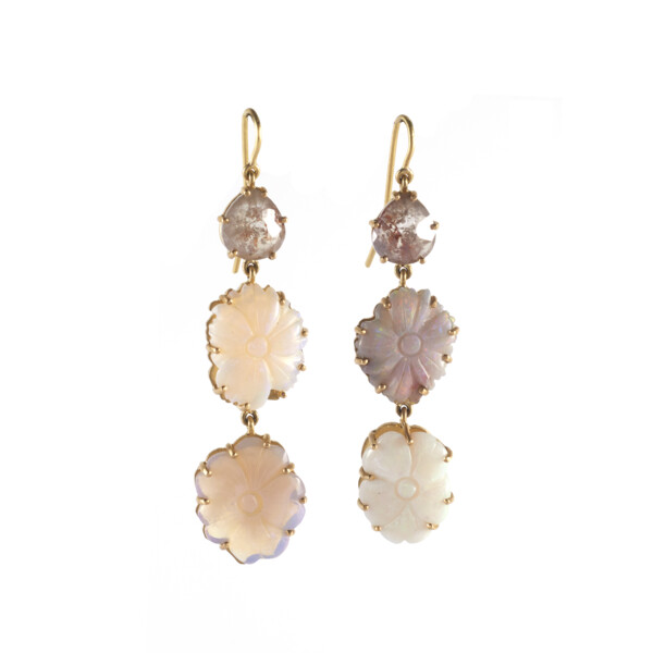 Closeup photo of 18Kt Hand carved opal earrings