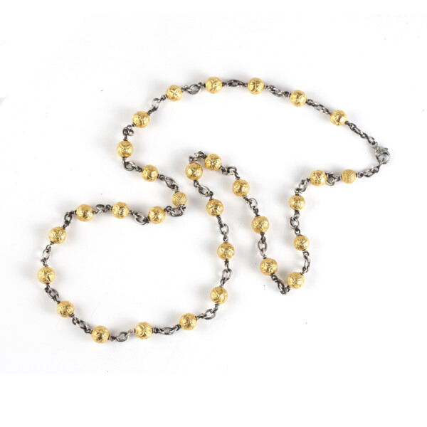 Closeup photo of 18Kt/SS ceremonial gold bead textured necklace