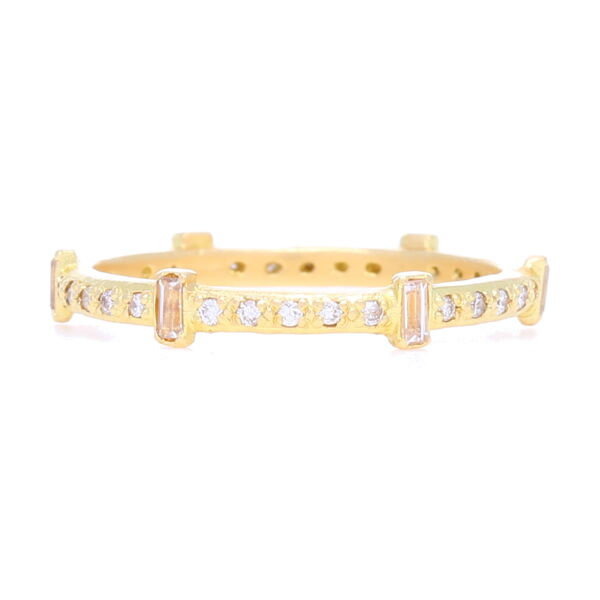 Closeup photo of Sueno 18k Gold Diamond & Sapphire Stack Ring