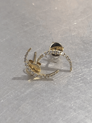 Collection: Old World Style #: 10319 Description: Old World Oxidized Sterling Silver and 18K Yellow Gold curved elongated earring with champagne diamonds. Diamond Weight 0.38ct